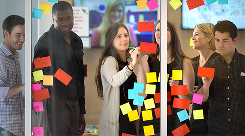 Section Image: Stacy Grau and students with post-it notes