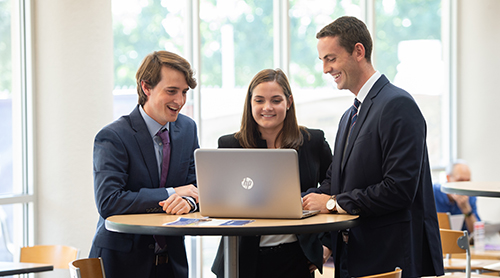 Section Image: three students at a laptop